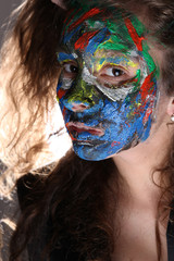 young woman with face-art