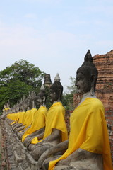 Buddha Statue in a row with sky