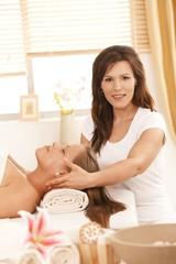 Masseur doing facial massage