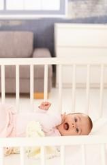 Cute baby girl in crib
