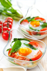 Baked egg with tomatoes and spinach