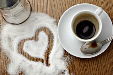 coffe cup drink and love heart shape in sugar