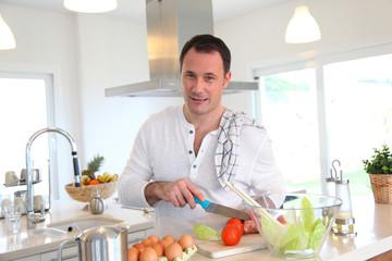 Man in kitchen preparing lunch