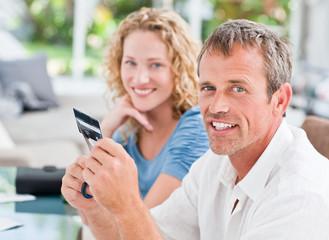 Man cutting up his credit card