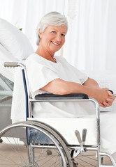Senior woman in her wheelchair looking at the camera