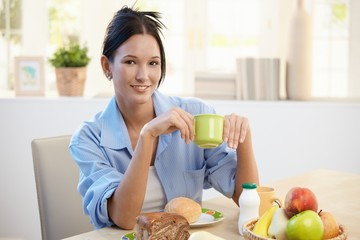 Breakfast portrait of young woman