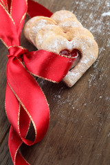 Red ribbon with shortbread hearts