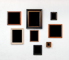 Picture frames on textured white wall