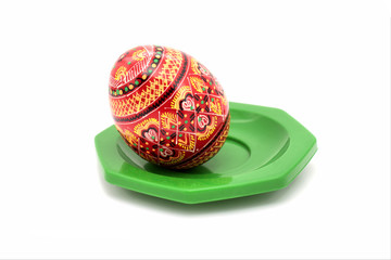 Painted egg on a plate