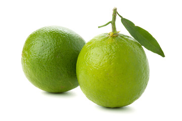 Two ripe limes with leaf
