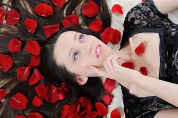 beautiful brunette in rose petals