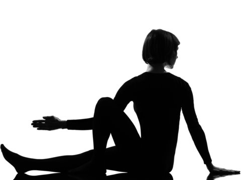 woman Marichyasana yoga sage pose