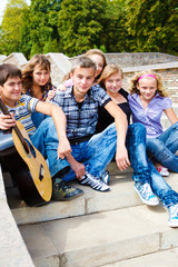 Teenage friends sitting on stairs
