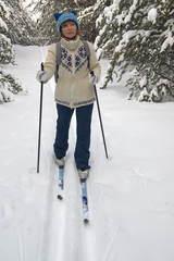 woman skiing in winter forest