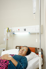 elderly patient resting in hospital bed