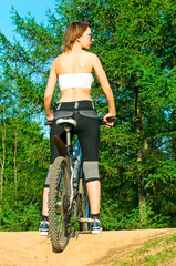 young woman on the bike