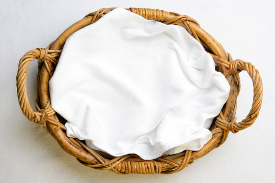 Top view on bakery basket with napkin