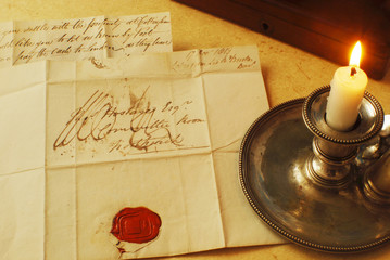 Old letter read by candle light from 1800's