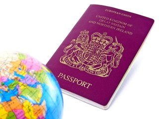 Passport & world globe on white background - DOF
