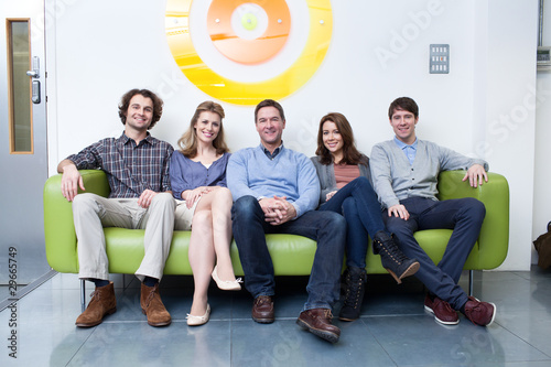 """""""Group Of People Sitting On Couch In Office"""" Stock Photo ..."""