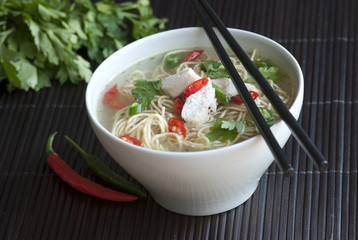 Chicken noodle soup with chili peppers