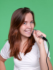 Portrait of female singer with microphone in hand