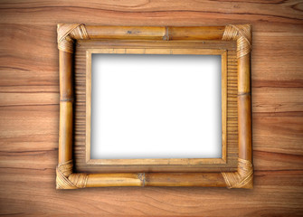 bamboo frame on wooden wall