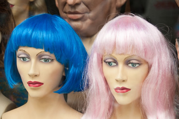 Two Mannikin heads with colorful wigs in a hairdresser saloon