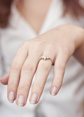 engagement ring inserted into finger