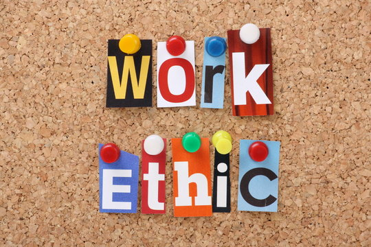 The words Work Ethic in magazine letters on a notice board