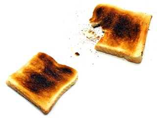 2 images of slightly burnt toast on a white background