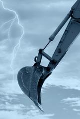 digger shovel under bark sky