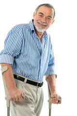 senior man on crutches smiling
