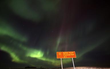 Northern Lights behind Saskatchewan road sign