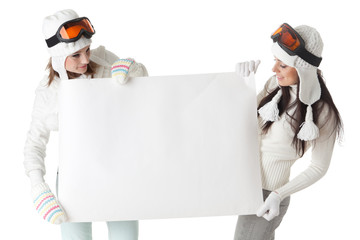 Young  women in ski glasses with empty board for the text.