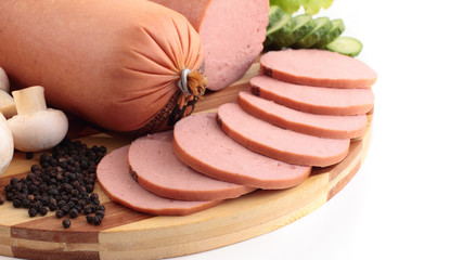 Sliced ham on a wooden board