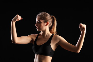 Fit woman flexing muscles during exercise workout