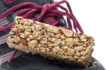 Energy Bar and Sneaker Shoe Sports Nutrition Concept