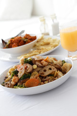 Mixed vegetables with other dishes in the background