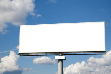 Blank billboard against blue sky useful for advertising