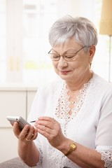 Elderly lady using smartphone