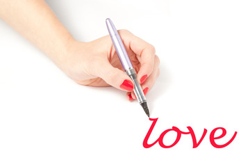 Female hand writing love with a purple pen on white background
