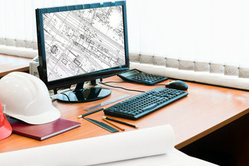 Working place with computer and project drawings in screen