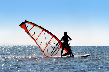 Windsurfer picks up the sail