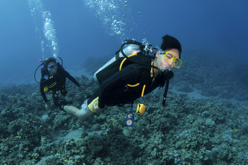Asian scuba divers having fun