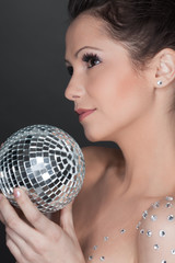 Young beautiful woman with mirrored ball