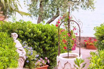 flower garden with stone well