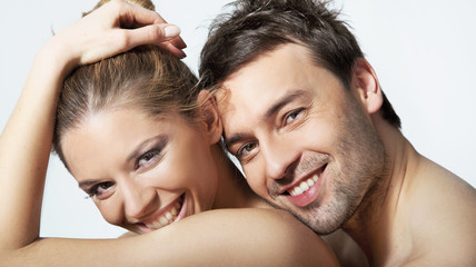 Portrait of happy young woman and man smiling together