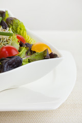 Salad meal in a white bowl