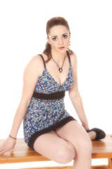 Woman dress sit on bench facing